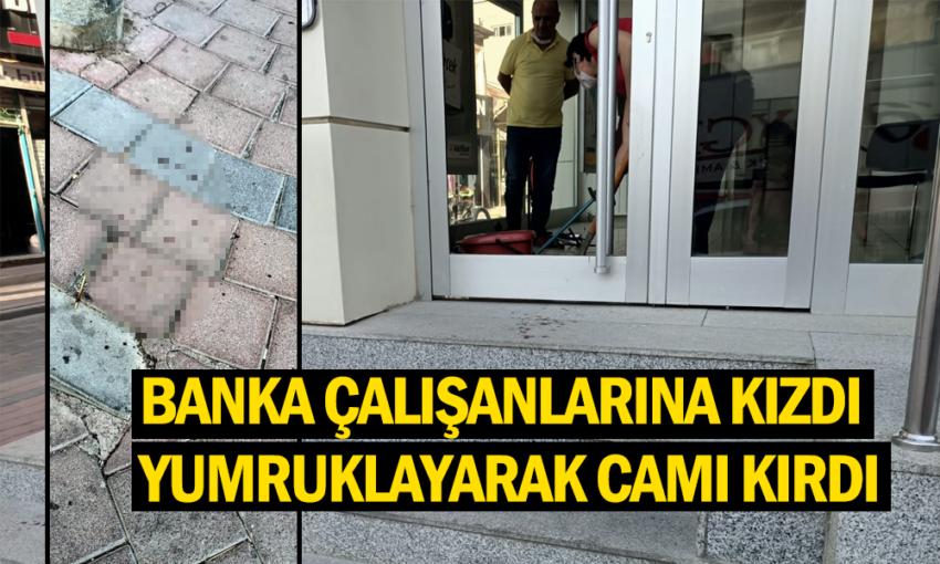 Banka çalışanlarına kızan şahıs camı kırdı